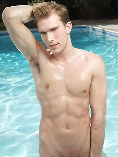 Preppy boy with a smoking hot body oils up and soaks up the sun outdoors