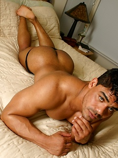 Solo Latin hunk with a muscular body teases his buffness and hot ass in the hotel bed