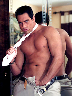 Hunk in a business suit does a slow striptease and jerks off his beautiful dick