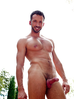 Bearded gay hunk poses outdoors at the pool and makes his beautiful cock rock hard
