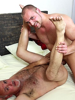 Jake Cruise spreads his legs widely so a friend can drill his tight asshole