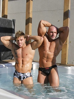 Hunk of a man Jason Barker poses in the nude with another muscular stallion