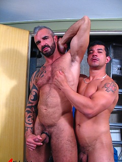 Gorgeous gay daddy flips his legs up and gets a hot rimjob from a younger man