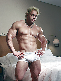 Blonde dude Ricky Wollensky shows off his giant muscles before stroking his rod