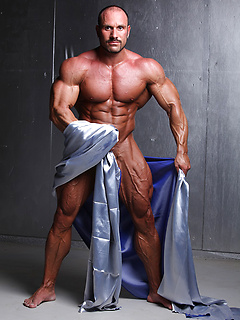 Hans Hoffmann displays his work as a body builder with fully flexed and sexy muscles