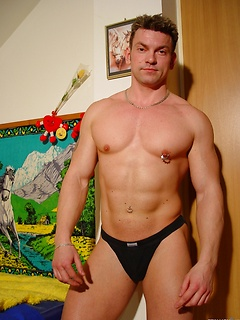 Well built solo gay hunk strips sensually and shows off his nipple ring
