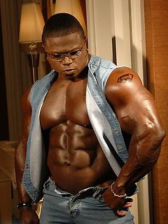 Black body builder Sean Jones models his incredible torso with great abs