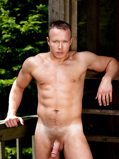 Thick hunk with sexy abs and a broad chest strips off his jockstrap outdoors
