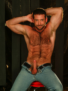 Strong dude slowly gets rid of the clothes and shows off his hairy body