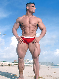 Hot hunk of a man Antonio flexes his giant muscles while wearing speedos