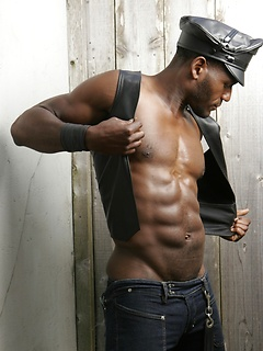 Solo black gay model with a fantastically hot body and a big cock that he strokes