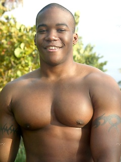 Muscular black dude teases with his insanely hot athletic body at the beach