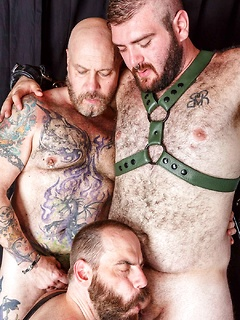 Three hairy dudes take it to the dungeon and pleasure their hard members
