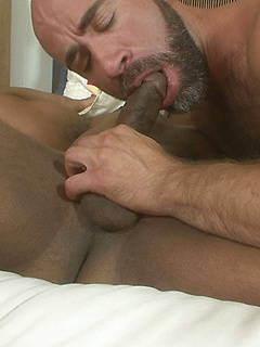 Horny black guy enjoys sucking a stiff dick before he gets his ass drilled