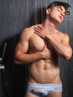 Handsome dude keeps his underwear on while posing erotically in the shower