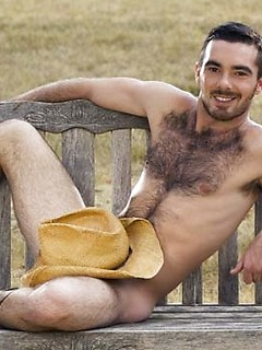 Hairy cowboy smiles and strips out on the farm to show off his thick half hard cock