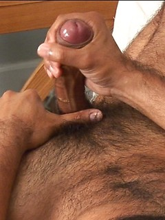 Hairy stallion Nicko Morales makes his large member explode all over his belly