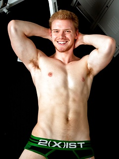 Hunky ginger gay guy with an uncut cock and rock hard abs he shows off