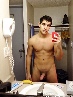 Hot guy with a gorgeous body and a great smile shoots selfies of his hard abs