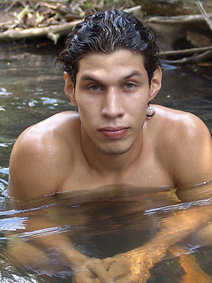 Latin hottie goes for a swim in the rive and plays with his cock until he cums