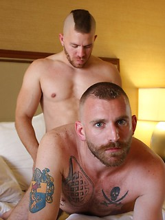 Tattooed and bearded bottom fucked by his hunky top with a big cock