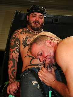 Tattooed bear feeds his cock to a hungry mouth and a nice tight ass
