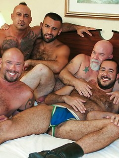Bears converge in a hotel room for a gangbang of a hairy ass bottom