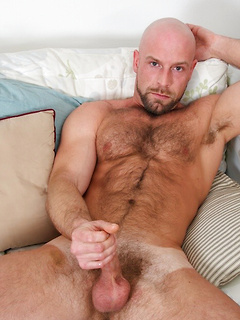 Hunky Dirk Willis strips to stroke his gorgeous cock and cum on his hairy stomach