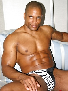Black dude shows off his muscles before he starts playing with his hard cock