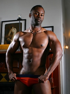 Muscle ebony dude shows his big black cock and strokes it