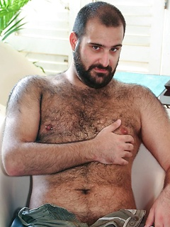 This bear is hairy all over and he shows every inch of his body in a striptease