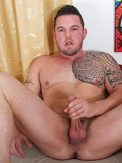 Ronnie J loves flexing his giant muscles and making his fat dick cum hard