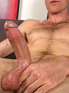 After a long day on the beach, this guy comes home and plays with his huge cock