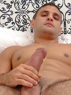 Hunk of a dude named Ronnie simply loves stroking on his throbbing boner