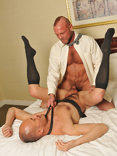 Daddy hunk in a hotel room with a hot bottom bitch that needs his cock up the ass