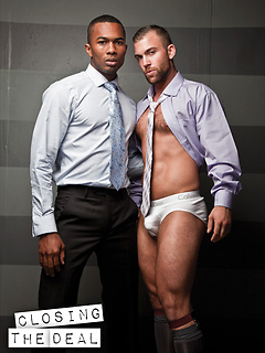 Sean Xavier takes off the suit before sucking on a friend's stiff cock