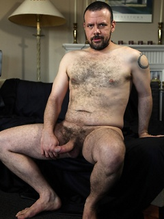 Hairy dude likes to strip down slowly before playing with his cock on the couch