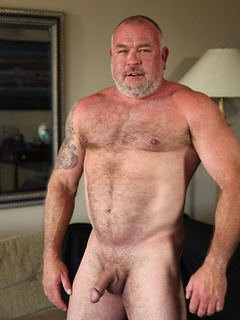 Daddy bear Dwaine strips to show off his burly body and jerk off solo