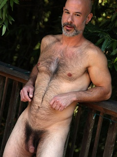 Solo daddy Evan Scott strips outdoors and his cock gets rock hard for stroking