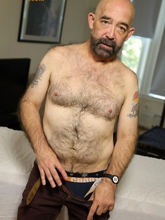 Older and hairy stallion strips down completely and strokes his hard dong