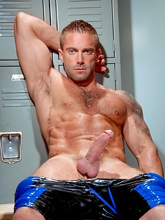 Latex shorts cling tight to the crotch and thighs of muscular Jake Genesis