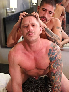 Bareback banging in the hotel room with a couple of hunky gay guys