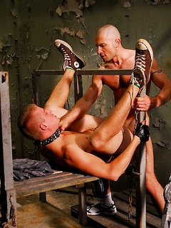 Kinky collared bottom in the dungeon pulls his legs back and gets fucked up the ass
