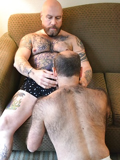 Bearded gay guy pleases a horny guy by drooling on his delicious shaft