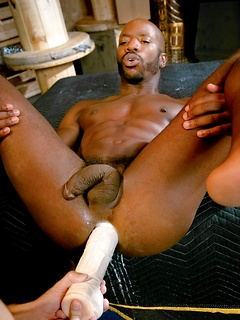 Black gay hottie Race Cooper spreads his legs for huge dildo anal fucking