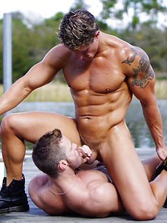 Two incredibly hot muscular studs Landon and Bryce fuck each other on a pier