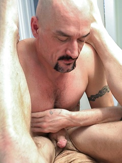 Bald bear slides his raw cock deep into the asshole of his tattooed bottom