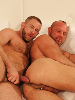 Sexy bear Shay Michaels plugs the bottom ass of Chad Brock with his bareback cock
