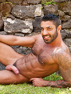 Muscular daddy with a hairy chest and pierced nipple pulls out his big cock outdoors