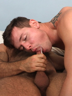 Bear hunk Brad Kalvo drives his bareback cock into a tight young asshole